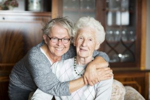 Senior loved one with family caregiver