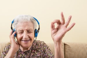 santa rosa ca in home care allows senior woman to enjoy listening to music from the comforts of home