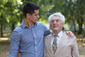 Caring grandson and his grandfather