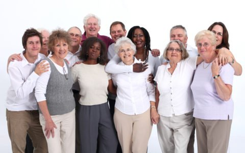 Close group of mixed age and senior people